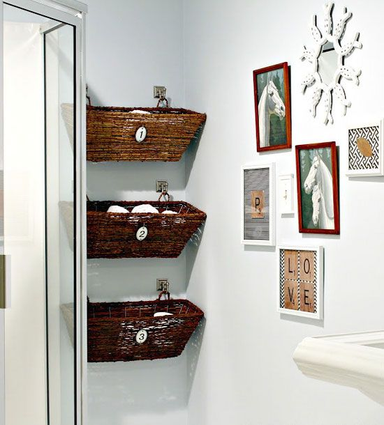 bathroom storage bins hung on the wall