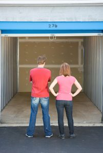Montrose man and woman gazing into an empty storage unit that they just rented from All Secure Storage.