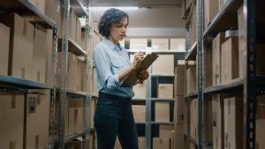 Montrose business woman tracking inventory in a storage unit