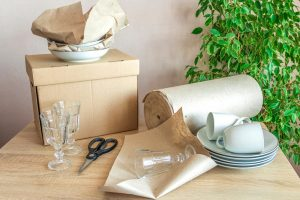 moving boxes for dishes and using packing paper is the best way to move and store dishes and glasware