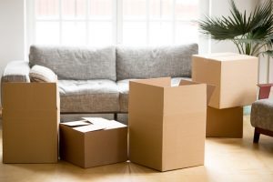 The couch and boxes shown in the picture show a household getting ready to move which is best for self storage buildings in the 10-foot range.