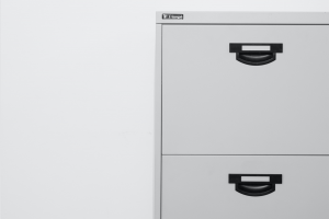 A grey filing cabinet, a good thing to get for home office storage.