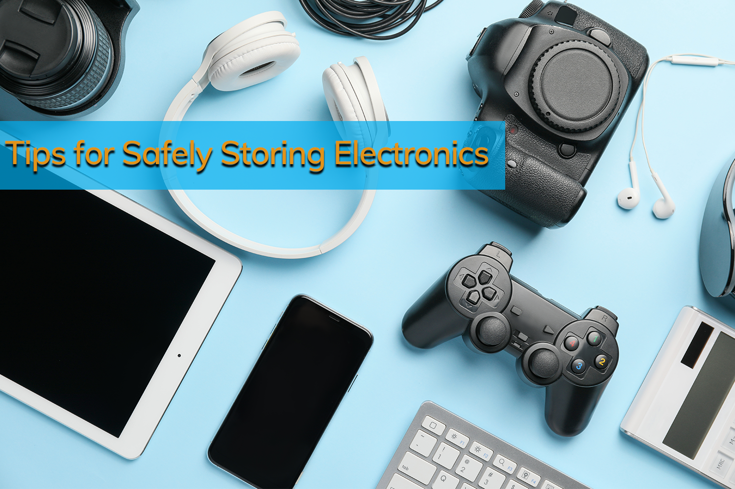 Electronics (a mcamera, headphones, smart phones, keyboard, cables, tablet, game controller) on a light blue background for storing electronics.